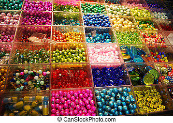 multicoloured beads sorted in boxes for sale