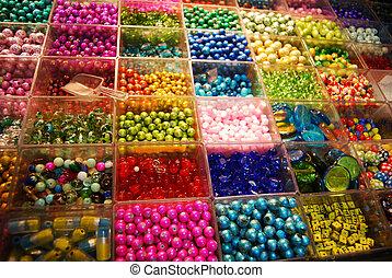 multicoloured beads in bijouterie shop - multicoloured beads...