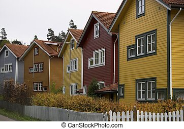 Multicoloured Houses - A row of residential houses, painted...