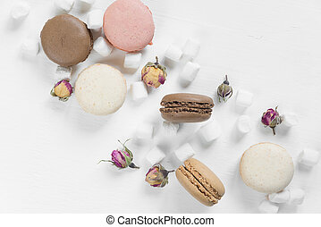 Multicoloured macaroons and marshmallow