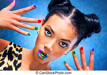 Young woman with multicoloured makeup.