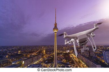 Multicopter flying over Berlin Cityscape