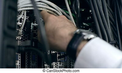 Multicore Computing - Close up of male hand disconnecting...