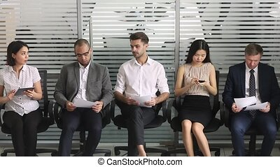 Multicultural business people applicants in row waiting for...