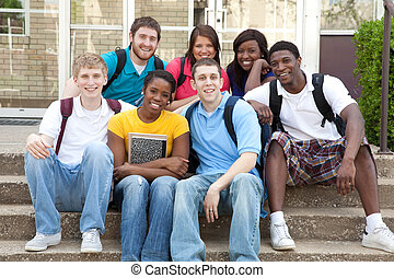 Multicultural College Students outside on campus - ...