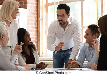 Multicultural coworkers working on project together at meeting in office