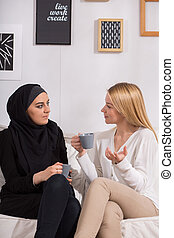Multicultural friends drinking coffee - Multicultural female...