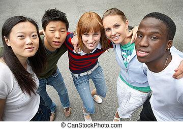 young people of different ethnic groups on the schoolyard - Jugendliche verschiedener ethnischer Gruppen auf einem Schulhof