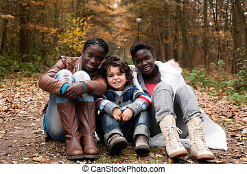 Multicultural sisters - Happy family with foster children in...