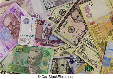Multicurrency background of the us dollars, russian rubles and ukrainian hryvnias