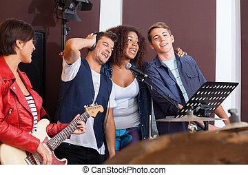 Multiethnic Band Performing In Recording Studio