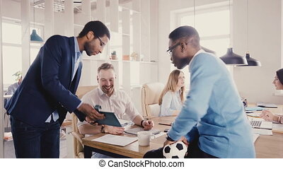 Multiethnic business people talk, shake hands at office...