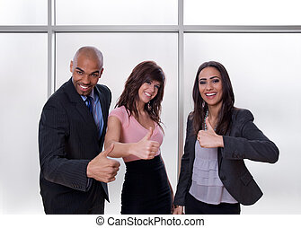 Multiethnic business team showing thumbs up