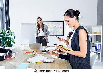 multiethnic businesswomen in office