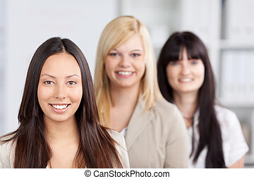 Multiethnic Businesswomen Smiling Together In Office