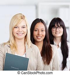 Multiethnic Businesswomen Standing Together In Office