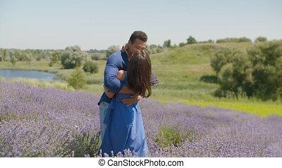 Multiethnic couple kissing in lavender field - Romantic...