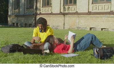 Multiethnic couple of students studying at campus