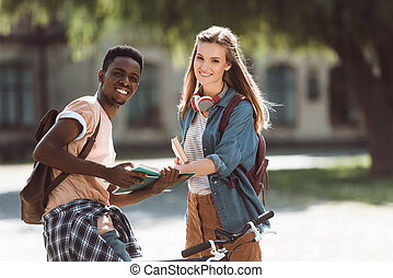 multiethnic couple reading book