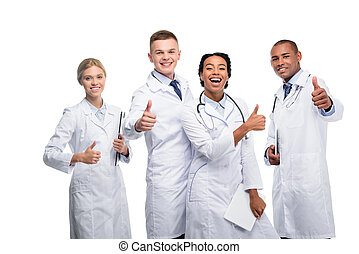 multiethnic doctors with thumbs up - multiethnic female and...