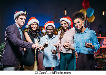 multiethnic friends at new year party - happy young...