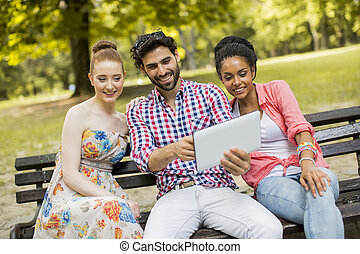 Multiethnic friends on the bench in park