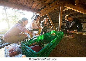 Multiethnic Friends Preparing Snacks In Shed