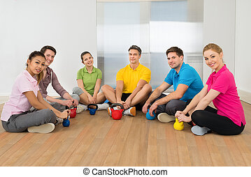 Multiethnic Friends Relaxing In Gym