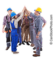 Multiethnic group of artisans doing a high five