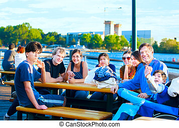 Multiethnic group of young people at lakeside park -...