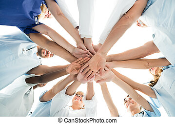 Multiethnic Medical Team Stacking Hands