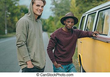 multiethnic men standing at minivan - happy multiethnic men ...