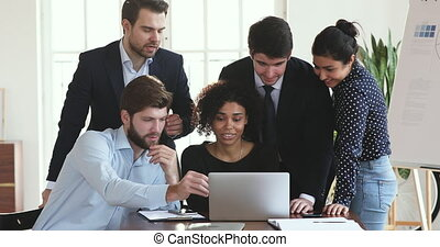 Multiethnic professional business team talking working together on laptop