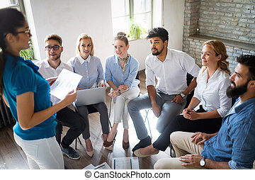 Multiethnic startup business team on meeting in modern bright office interior brainstorming
