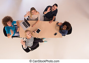 Multiethnic startup business team on meeting top view