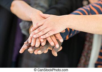 Multiethnic University Students Stacking Hands