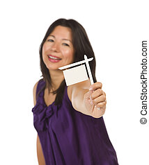 Multiethnic Woman Holding Small Blank Real Estate Sign in Hand