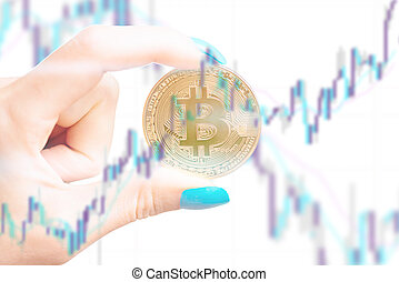 Multiexposure of hand with bitcoin and diagram.