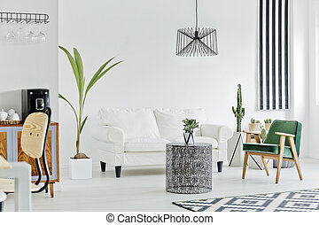 Multifunctional interior with white sofa, carpet, armchair ...