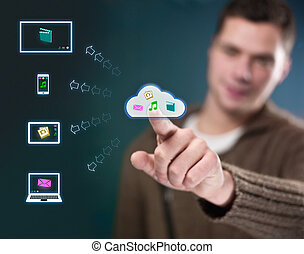 Young man working with multimedia cloud