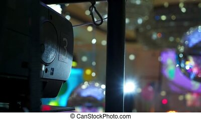 Multimedia projector and discoball at the party indoors