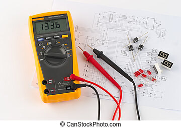 a true rms multimeter and an elelctronic circuit diagram on paper