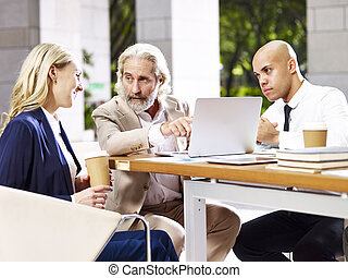 multinational and multiethnic corporate executives business people meeting in lobby of modern office building.