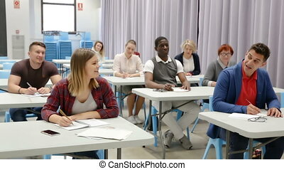 Multinational group of different age students at extension courses