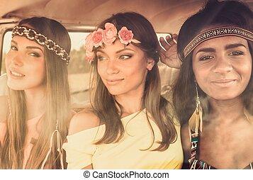 Multinational hippie girls in a van