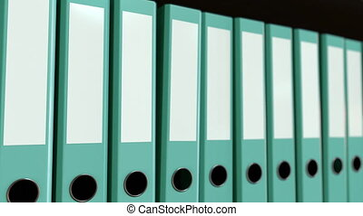 Multiple blue office binders. Seamless loop 4K animation -...