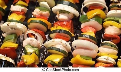 Multiple colorful and tasty grilled shashliks on outdoor ...