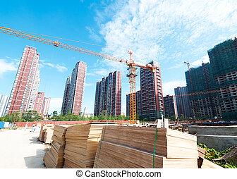 multiple cranes working on huge construction site
