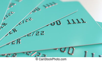Multiple cyan bank cards, loopable motion background -...