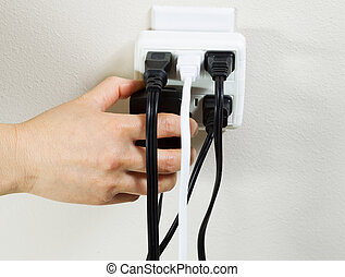 Multiple Electrical Outlets - Photo of female hand plugging...